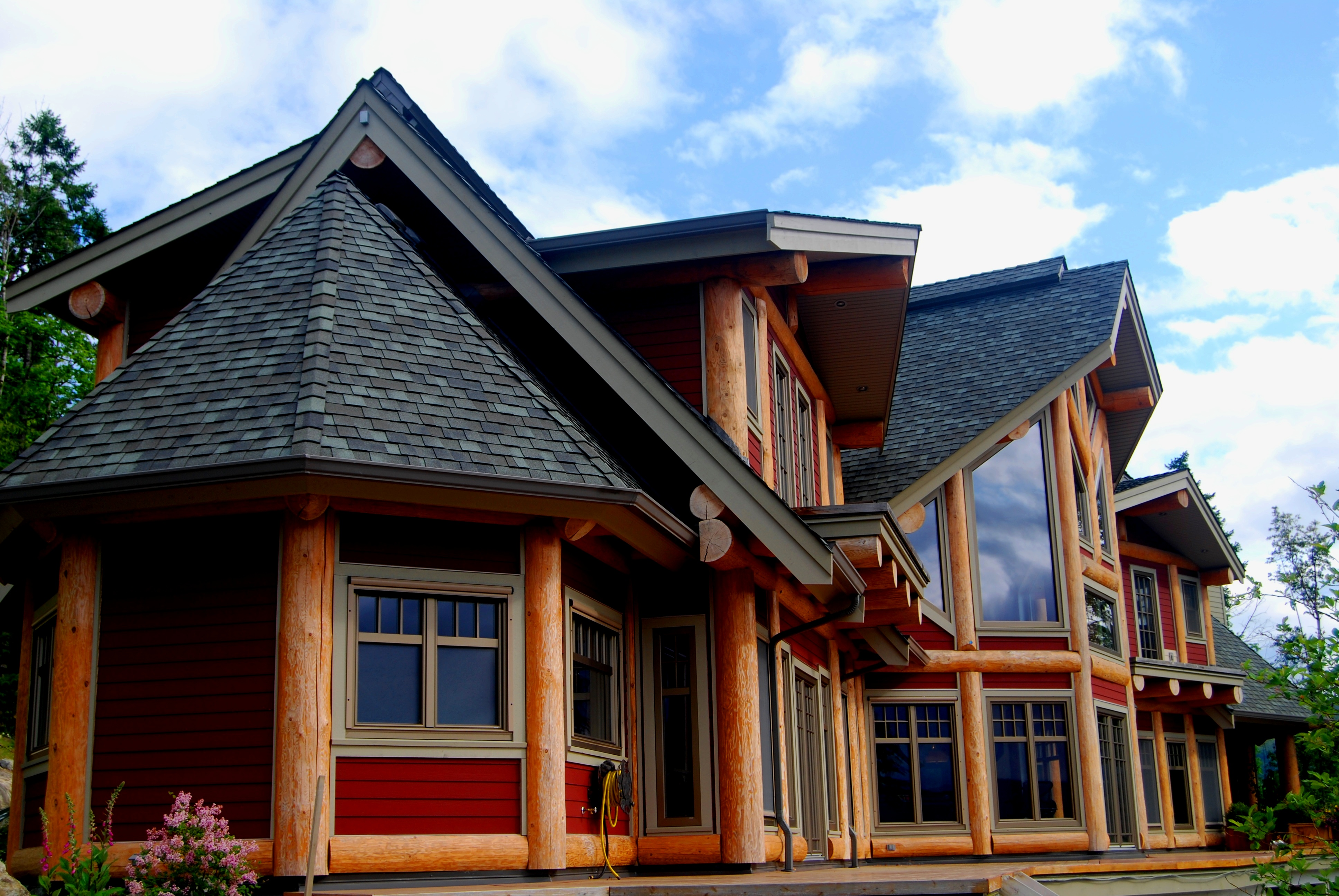 Post beam log homes log joinery timber frame for Post and beam homes cost