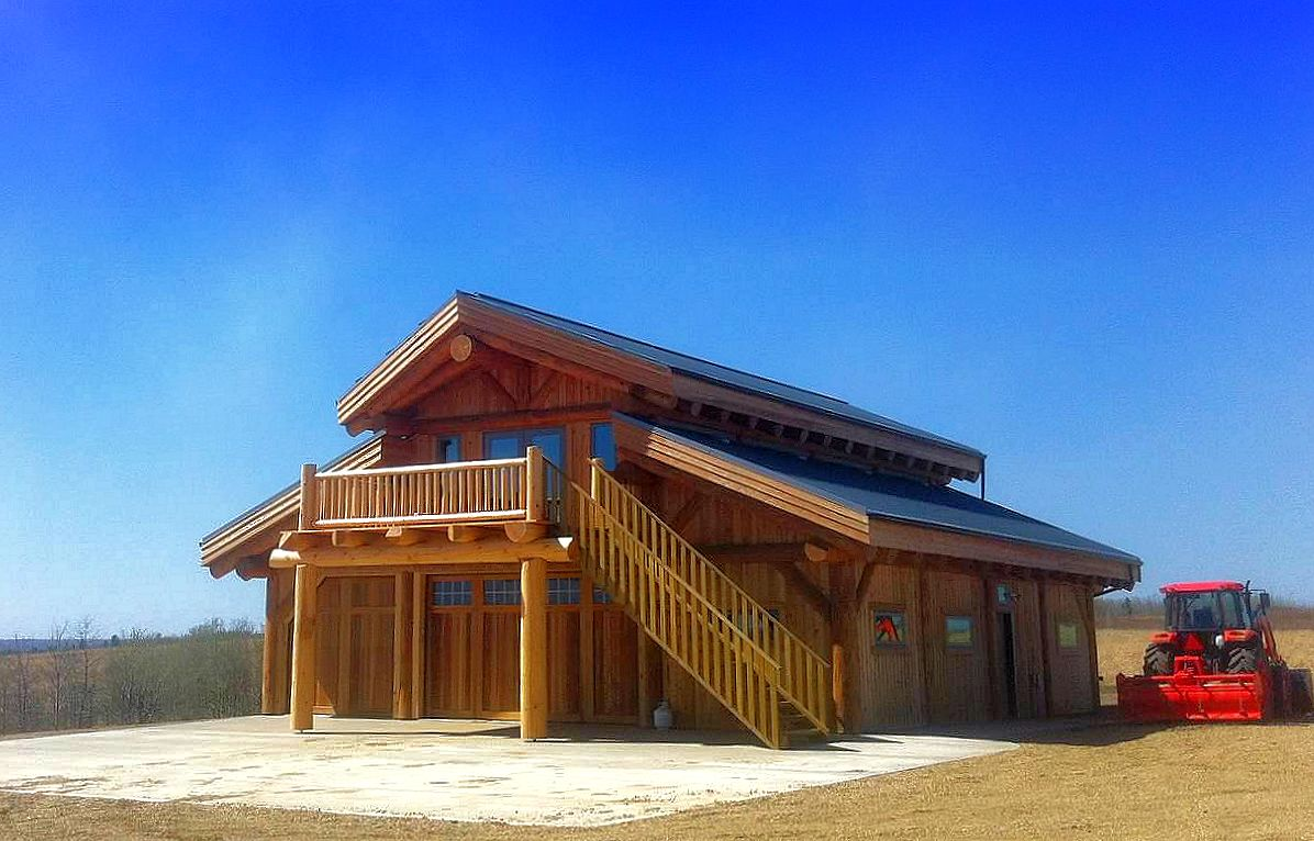 Post beam log homes log joinery timber frame for Log barn homes