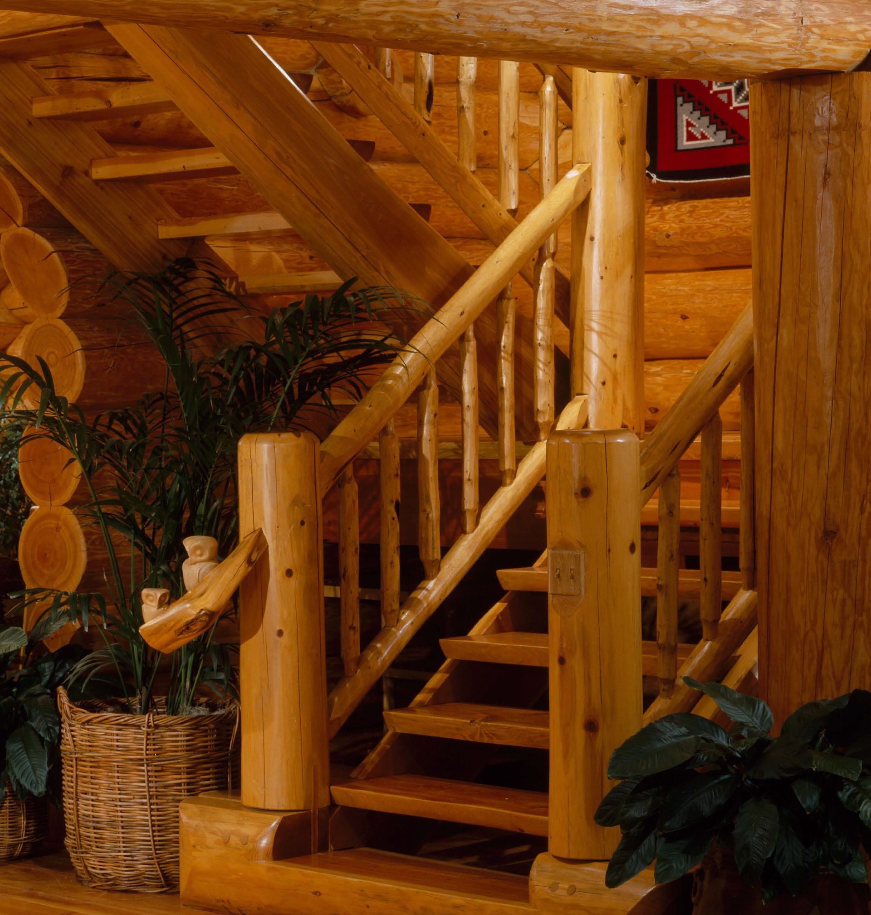 Custom Hand Made Log Staircase With Owl Carvings On Rustic Railing In  Wyoming Log Home.
