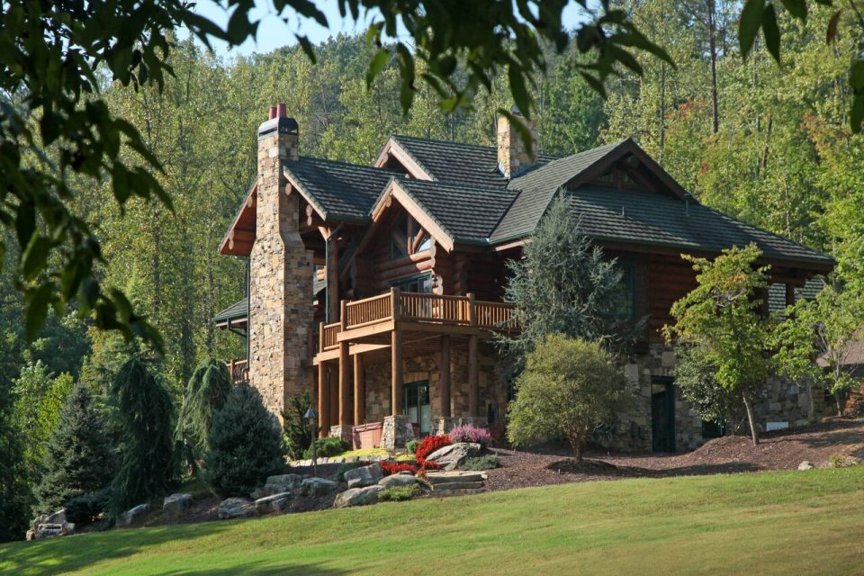 Log home photos log homes log post and beam timber frame for Luxury log home plans with pictures
