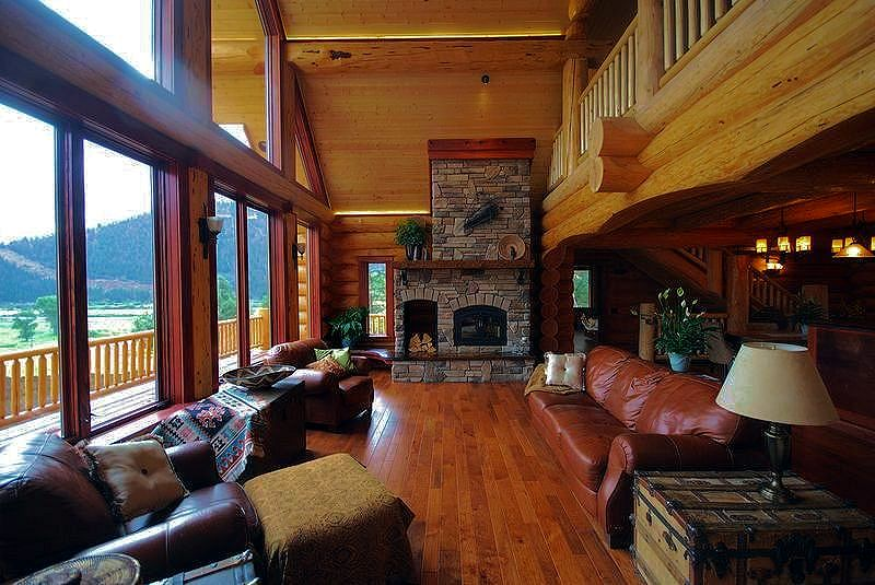 Log cabin living rooms and great rooms north american for Great american log homes